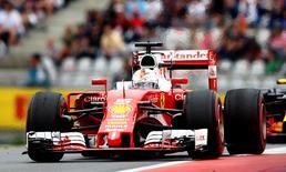 Formula One - Grand Prix of Austria - Spielberg, Austria - 3/7/16 -  Ferrari Formula One driver Sebastian Vettel of Germany drives during the race. REUTERS/Dominic Ebenbichler