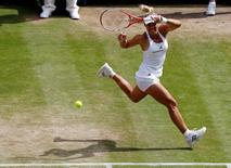 Britain Tennis - Wimbledon - All England Lawn Tennis & Croquet Club, Wimbledon, England - 7/7/16 Germany's Angelique Kerber in action against USA's Venus Williams REUTERS/Stefan Wermuth