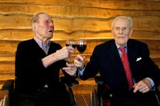 The world's oldest living twin brothers, Paulus (L) and Pieter Langerock from Belgium, 102, toast with a glass of red wine at the Ter Venne retirement home in Sint-Martens-Latem, Belgium.  REUTERS/Francois Lenoir