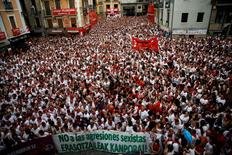 People take part in a protest against sexual violence against women during the San Fermin festival in Pamplona, northern Spain, July 7, 2016. REUTERS/Susana Vera