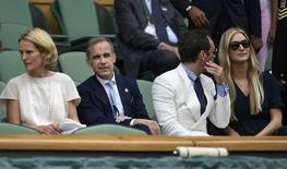 Britain Tennis - Wimbledon - All England Lawn Tennis & Croquet Club, Wimbledon, England - 8/7/16 Governor of the Bank of England Mark Carney with his wife Diana and Actor Jude Law in the royal box before the start of play REUTERS/Tony O'Brien