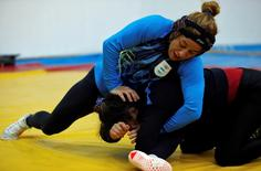 Argentine Olympic wrestler Patricia Bermudez (top) fights with training partner Evelyn Sosa at the Cenard Sports Complex ahead of their participation in the 2016 Rio Olympics in Buenos Aires, Argentina, July 5, 2016. REUTERS/Marcos Brindicci