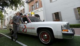 "Director of the movie Paul Feig poses next to ECTO-1, the vehicle used in the upcoming movie ""Ghostbusters,"" during a photo-call at Sony Studios in Culver City, California March 2, 2016.    REUTERS/Mario Anzuoni"