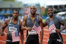 Jul 9, 2016; Eugene, OR, USA; Ameer Webb (left) and LaShawn Merritt  (middle) and Justin Gatlin (right) react after competing during the men's 200m final in the 2016 U.S. Olympic track and field team trials at Hayward Field. Mandatory Credit: Glenn Andrews-USA TODAY Sports