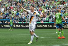Jul 9, 2016; Seattle, WA, USA; Los Angeles Galaxy forward Robbie Keane (7) celebrates after scoring a goal against the Seattle Sounders FC during the first half at CenturyLink Field. Los Angeles defeated Seattle, 1-0. Mandatory Credit: Joe Nicholson-USA TODAY Sports