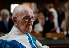Father Jacques Clemens attends a mass at St. Benoit church in Nalinnes, Belgium, July 10, 2016.   REUTERS/Francois Lenoir