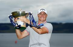 Britain Golf - Aberdeen Asset Management Scottish Open - Castle Stuart Golf Links, Inverness, Scotland - 10/7/16 Sweden's Alex Noren celebrates with the trophy after winning the Scottish Open  Action Images via Reuters / Jason Cairnduff Livepic