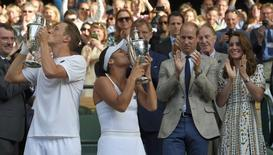 Britain Tennis - Wimbledon - All England Lawn Tennis & Croquet Club, Wimbledon, England - 10/7/16 Great Britain's Heather Watson and Finland's Henri Kontinen celebrate winning the mixed doubles final with the trophies as Britain's Prince William and Kate, Duchess of Cambridge applaud REUTERS/Toby Melville