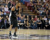 Feb 24, 2016; Sacramento, CA, USA; San Antonio Spurs guard Patty Mills (8) celebrates after a basket against the Sacramento Kings during the third quarter at Sleep Train Arena. The San Antonio Spurs defeated the Sacramento Kings 108-92. Mandatory Credit: Kelley L Cox-USA TODAY Sports