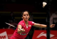 India's Saina Nehwal returns a shot to China's Wang Yihan during their women's singles  quarter-final badminton match at the BWF World Championship in Jakarta, Indonesia August 14, 2015.  REUTERS/Darren Whiteside