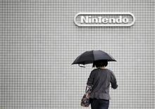 A woman walks past the logo of Nintendo Co Ltd in Tokyo May 7, 2015.  REUTERS/Toru Hanai