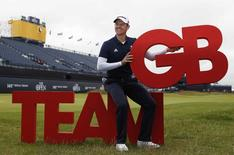 Golf-British Open - England's Justin Rose poses with the Team GB logo after being unveiled as part of Britain's Olympic Team - Royal Troon, Scotland, Britain - 13/07/2016.   REUTERS/Paul Childs