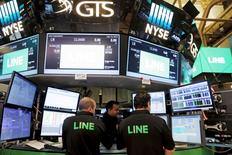 Traders look over their monitors as Japan's Line Corp. offers up its IPO on the floor of the New York Stock Exchange (NYSE) in New York City, New York, U.S. July 14, 2016. REUTERS/Brendan McDermid