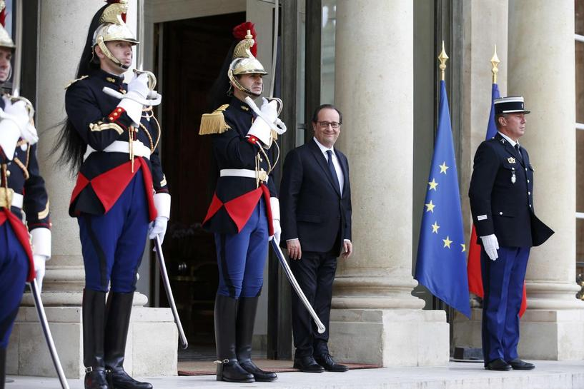 France's Hollande defends record on jobs, security as elections loom