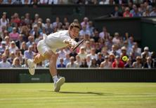 Jul 10 2016; London, United Kingdom; Milos Raonic (CAN) in action during his match against Andy Murray (GBR) on day 14 of the 2016 The Championships Wimbledon. Susan Mullane-USA TODAY Sports