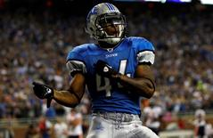 Detroit Lions running back Jahvid Best celebrates in the endzone after an 88 yard touchdown run against the Chicago Bears in the third quarter of their NFL football game in Detroit, Michigan, October 10, 2011. REUTERS/Mike Segar