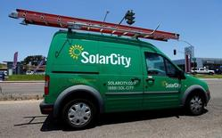 A SolarCity vehicle is seen on the road in San Diego, California, U.S. June 22, 2016.        REUTERS/Mike Blake