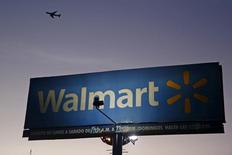 Aircraft flies over a Wal-Mart billboard in Mexico City March 24, 2015. REUTERS/Edgard Garrido/File Photo