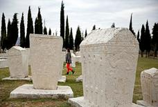 A woman walks near the Radimlja necropolis near Stolac March 10, 2015. REUTERS/Dado Ruvic/File Photo