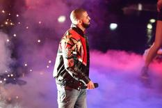 Feb 14, 2016; Toronto, Ontario, CAN; Rapper, singer, songwriter, record producer and actor Drake looks on during player introductions prior to the NBA All Star Game at Air Canada Centre. Peter Llewellyn-USA TODAY Sports