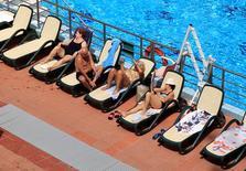 People sunbathe at the Lukacs Bath in Budapest, Hungary June 28, 2016. REUTERS/Bernadett Szabo