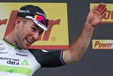 Team Dimension Data rider Mark Cavendish of Britain reacts on podium after winning the stage. REUTERS/Juan Medina