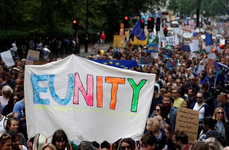 People hold banners during a 'March for Europe' demonstration against Britain's decision to leave the European Union, in central London, Britain July 2, 2016.  REUTERS/Tom Jacobs