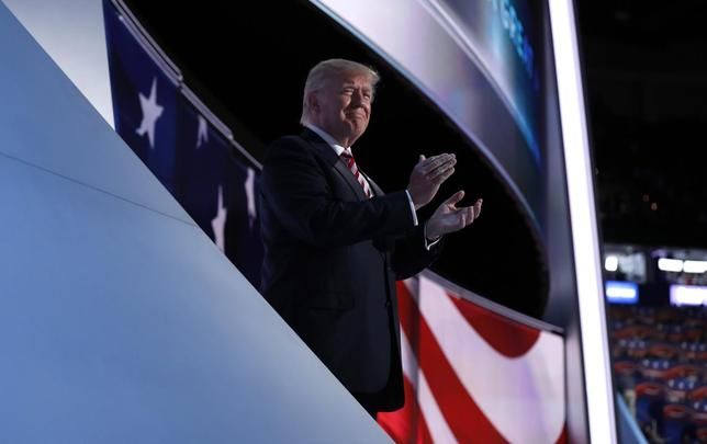 Republican U.S. presidential nominee Donald Trump applauds onstage as his running-mate Indiana Governor Mike Pence concludes his speech during the third night of the Republican National Convention in Cleveland, Ohio, U.S. July 20, 2016. REUTERS/Mark Kauzlarich