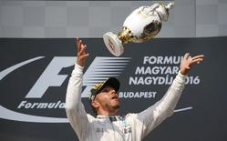 Hungary Formula One - F1 - Hungarian Grand Prix 2016 - Hungaroring, Hungary - 24/7/16 Mercedes' Lewis Hamilton celebrates after winning the race  REUTERS/Laszlo Balogh