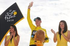 Cycling - Tour de France cycling race - The 113-km (70,4 miles) Stage 21 from Chantilly to Paris, France - 24/07/2016  - Yellow jersey leader and overall winner Team Sky rider Chris Froome of Britain celebrates on the podium.     REUTERS/Pascal Rossignol