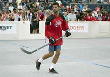 Jul 24, 2016; Toronto, Ontario, Novak Djokovic of Serbia participates during the Rogers Cup Sportsnet Ball Hockey Challenge during qualifying of the Rogers Cup tennis tournament at the Aviva Centre. Mandatory Credit: Nick Turchiaro-USA TODAY Sports