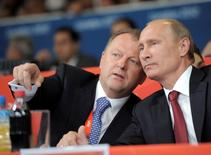 Russian President Vladimir Putin (R) and president of the International Judo Federation (IJF) Marius Vizer chat as they watch the final of the judo competition at the London 2012 Olympic Games, Britain, August 2, 2012. Picture taken August 2, 2012. Sputnik/Kremlin/Alexei Druzhinin/via REUTERS
