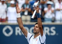 Jul 27, 2016; Toronto, Ontario, Canada;   Novak Djokovic of Serbia salutes fans after winning his match against  Gilles Muller of Luxembourg  on day three of the Rogers Cup tennis tournament at Aviva Centre. Dan Hamilton-USA TODAY Sports