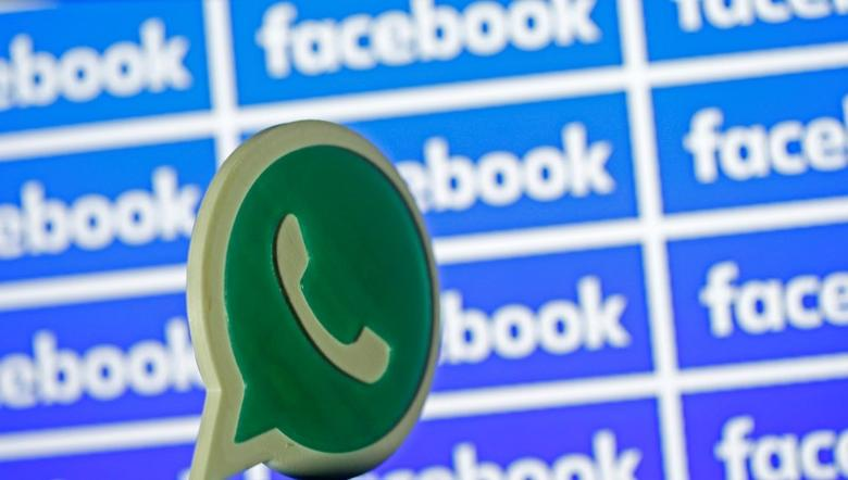 A 3D printed Whatsapp  logo is seen in front of a displayed Facebook logo in this illustration taken April 28, 2016. REUTERS/Dado Ruvic/Illustration