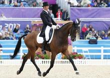 Mark Todd of New Zealand rides Campino during the equestrian Eventing Individual Dressage Day 2 in the Greenwich Park during the London 2012 Olympic Games, July 29, 2012.  REUTERS/Mike Hutchings