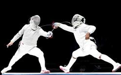 Russia's Alexey Yakimenko (L) competes against Daryl Homer of the U.S. during their men's sabre final at the World Fencing Championships in Moscow July 14, 2015. REUTERS/Grigory Dukor