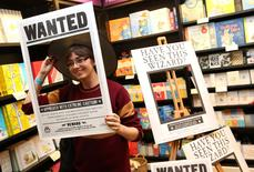 A fan poses for a photograph at an event to mark the release of the book of the play of Harry Potter and the Cursed Child parts One and Two at a bookstore in London, Britain July 30, 2016. REUTERS/Neil Hall