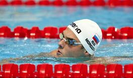 Russia's Vladimir Morozov reacts during the men's 100m freestyle semi-final at the Aquatics World Championships in Kazan, Russia, August 5, 2015. Morozov was disqualified for a false start.   REUTERS/Hannibal Hanschke  - RTX1N61F
