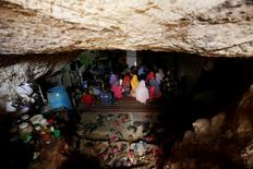 Internally displaced children attend a class inside a cave in the rebel-controlled village of Tramla, in Idlib province, Syria March 27, 2016. REUTERS/Khalil Ashawi