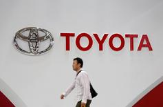 A man walks past a Toyota Motor Corp logo at the company's showroom in Tokyo, Japan June 14, 2016.    REUTERS/Toru Hanai