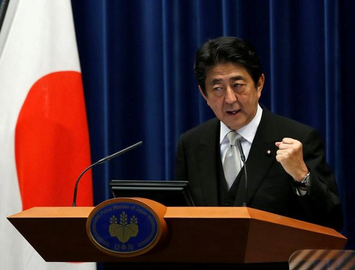 Japanese PM Abe: economy is top priority for new cabinet | Reuters