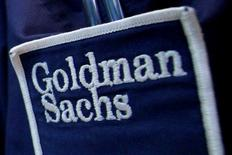 The logo of Goldman Sachs (GS) is seen on the clothing of a trader working at the Goldman Sachs stall on the floor of the New York Stock Exchange, United States April 16, 2012. REUTERS/Brendan McDermid/File Photo