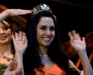 Syrian refugee Ninorta Bahno reacts during the crowning ceremony for the new Trier wine queen in Trier, Germany, August 3, 2016.  REUTERS/Ralph Orlowski