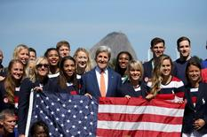 U.S. Secretary of State John Kerry poses with members of the U.S. Olympic team at the Brazilian Naval Academy in Rio de Janeiro.  REUTERS/Shannon Stapleton