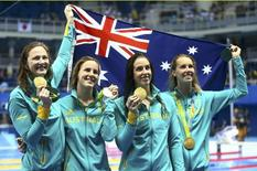 2016 Rio Olympics - Swimming - Victory Ceremony - Women's 4 x 100m Freestyle Relay Victory Ceremony - Olympic Aquatics Stadium - Rio de Janeiro, Brazil - 06/08/2016.(L-R) Cate Campbell (AUS) of Australia, Bronte Campbell (AUS) of Australia, Brittany Elmslie (AUS) of Australia and Emma McKeon (AUS) of Australia pose with their gold medals and the Australian flag.      REUTERS/Dominic Ebenbichler