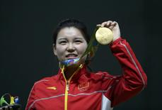2016 Rio Olympics - Shooting - Victory Ceremony - Women's 10m Air Pistol Victory Ceremony - Olympic Shooting Centre - Rio de Janeiro, Brazil - 07/08/2016. Zhang Mengxue (CHN) of China (PRC) poses with her gold medal.  REUTERS/Edgard Garrido