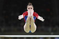 2016 Rio Olympics - Artistic Gymnastics - Preliminary - Women's Qualification - Subdivisions - Rio Olympic Arena - Rio de Janeiro, Brazil - 07/08/2016. Aliya Mustafina (RUS) of Russia competes on the uneven bars during the women's qualifications.  REUTERS/Damir Sagolj
