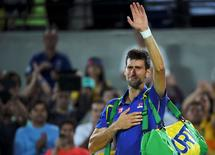 2016 Rio Olympics - Tennis - Preliminary - Men's Singles First Round - Olympic Tennis Centre - Rio de Janeiro, Brazil - 07/08/2016. Novak Djokovic (SRB) of Serbia reacts after losing his match against Juan Martin Del Potro (ARG) of Argentina. REUTERS/Toby Melville