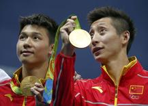2016 Rio Olympics - Diving - Men's Synchronised 10m Platform Victory Ceremony - Maria Lenk Aquatics Centre - Rio de Janeiro, Brazil - 08/08/2016.Chen Aisen (CHN) and Lin Yue (CHN) of China (PRC) pose with their medals.  REUTERS/David Gray