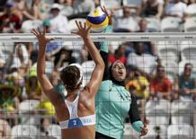 2016 Rio Olympics - Beach Volleyball - Women's Preliminary - Beach Volleyball Arena - Rio de Janeiro, Brazil - 09/08/2016. Doaa Elghobashy (EGY) of Egypt and Laura Giombini (ITA) of Italy compete.   REUTERS/Ricardo Moraes